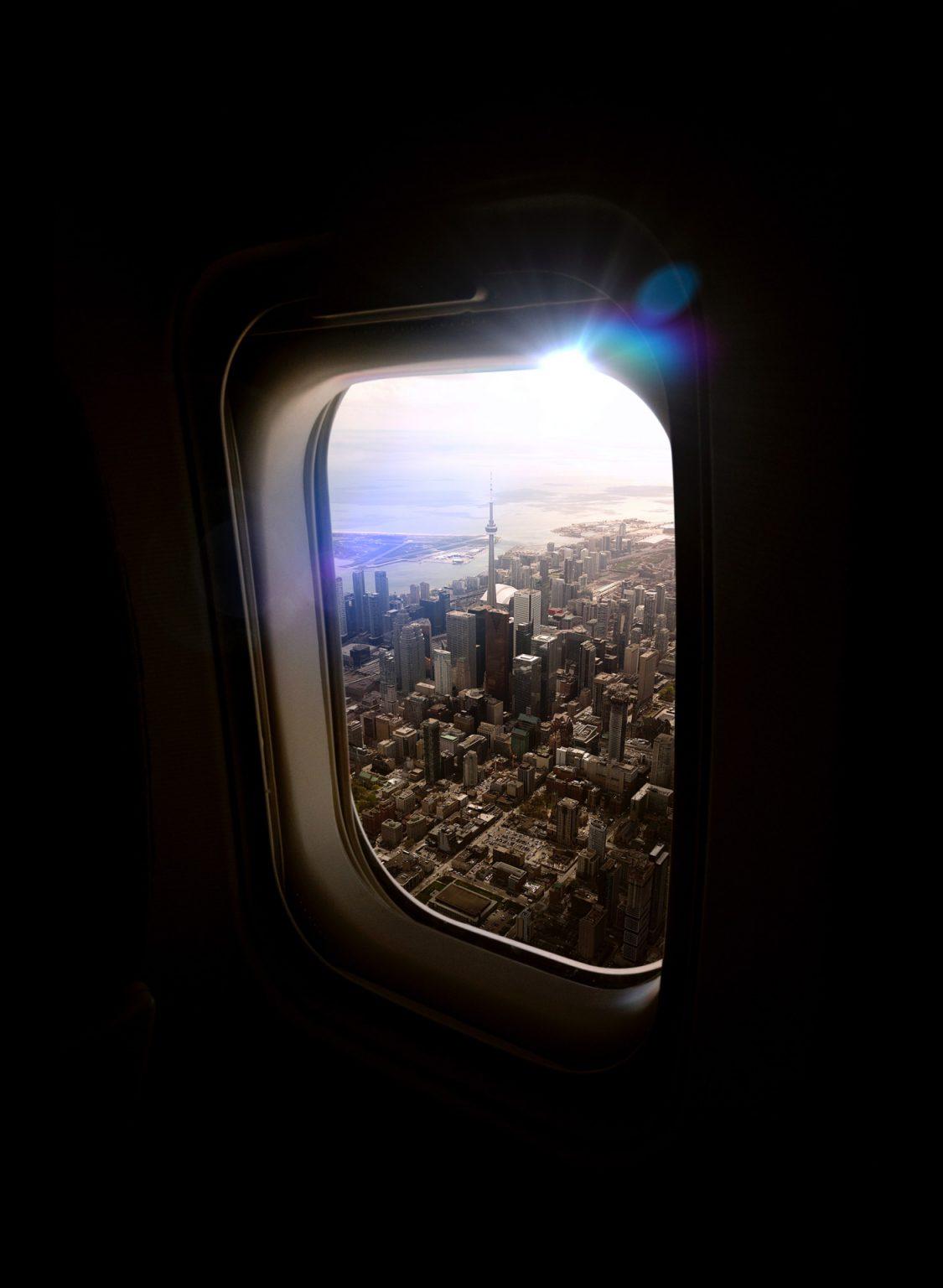Aerial view of Downtown Toronto through an airplane window.