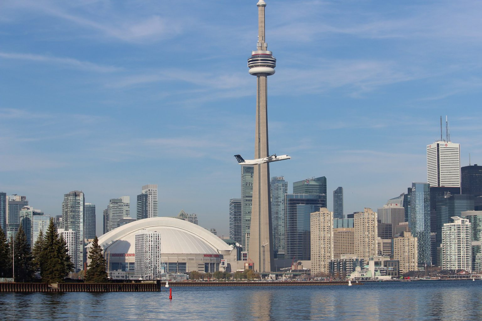 Skyline of Toronto with a plane taking off